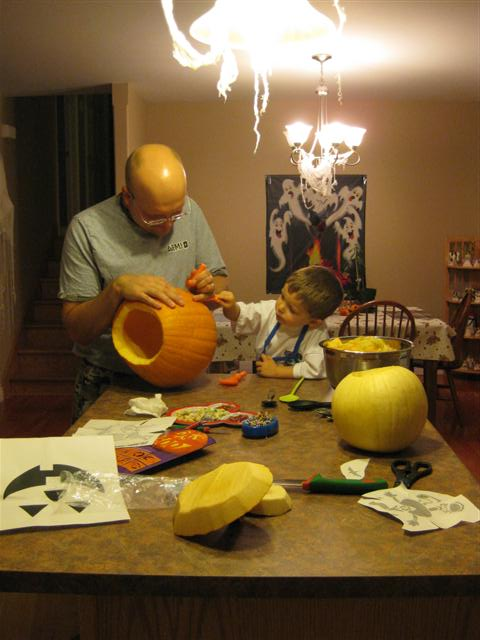 Helping carve the pumpkins.