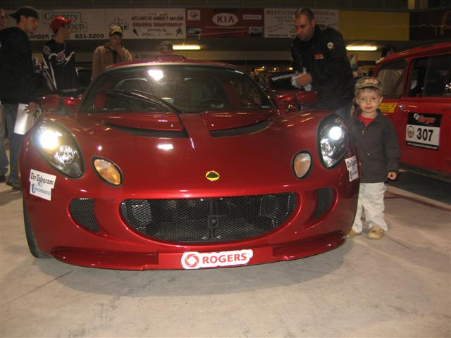 Nicholas posing with a Lotus Exige